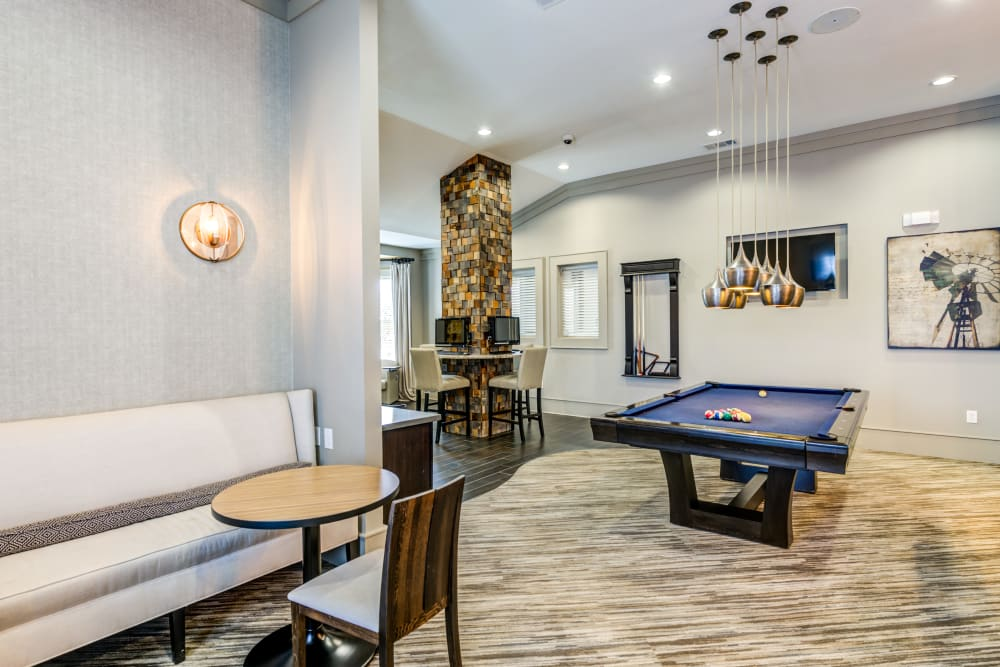 Seating and pool table in the clubhouse at The Sovereign in Fort Worth, Texas