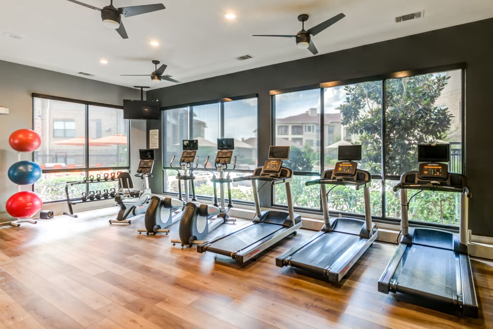 Treadmills and stationary bikes in the fitness center at The Sovereign in Fort Worth, Texas
