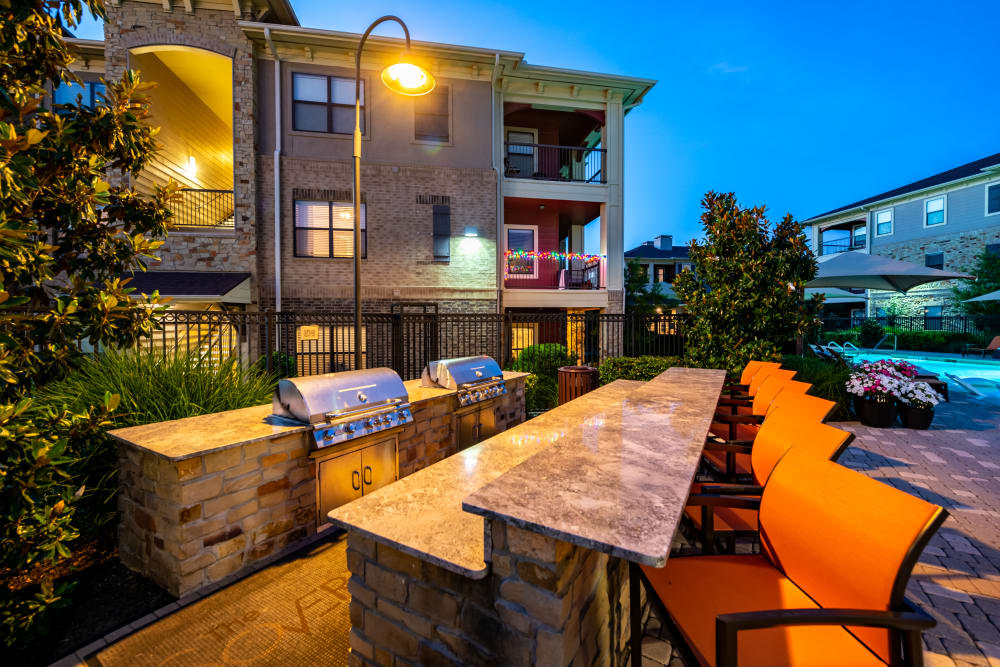 Outdoor barbecue area at The Sovereign in Fort Worth, Texas