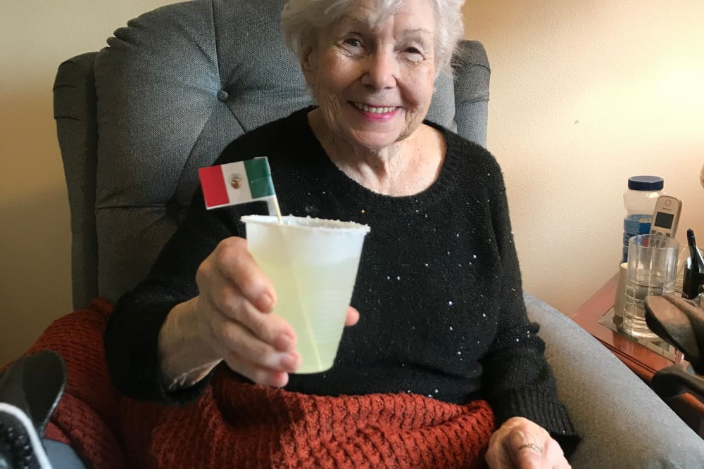 Resident enjoying a drink at Edencrest at The Legacy in Norwalk, Iowa