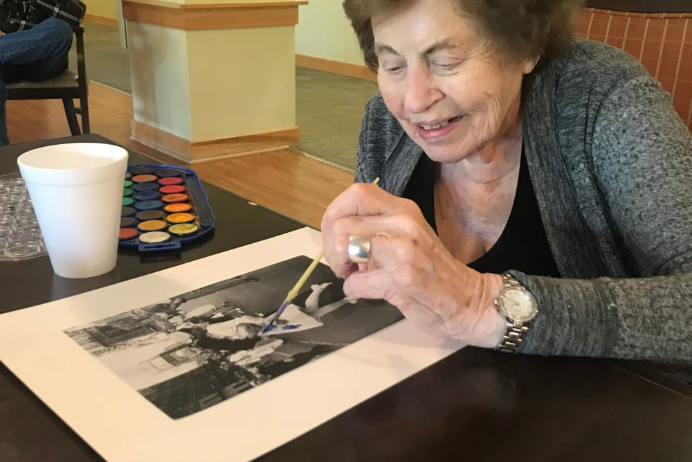 Resident enjoying time painting at Edencrest at Riverwoods in Des Moines, Iowa