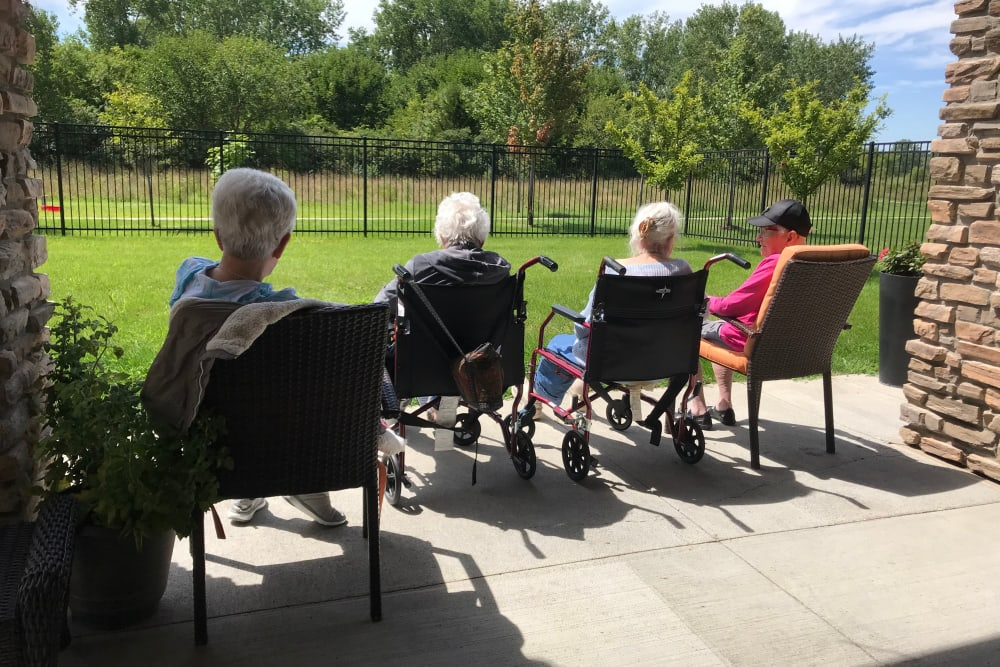 Residents enjoying fresh air at Edencrest at Riverwoods in Des Moines, Iowa
