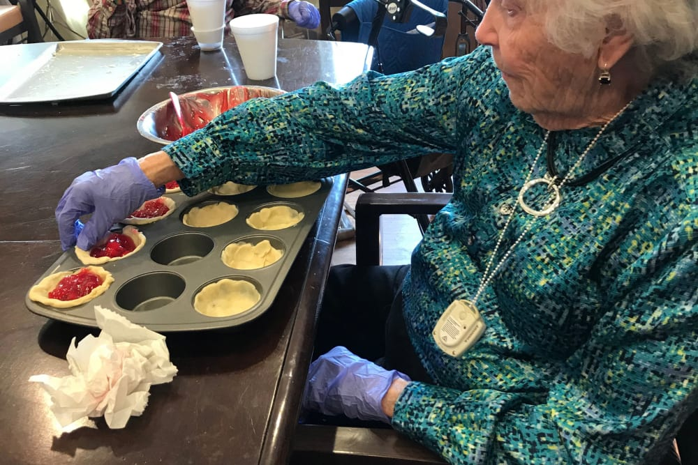 Resident baking at Edencrest at Riverwoods in Des Moines, Iowa