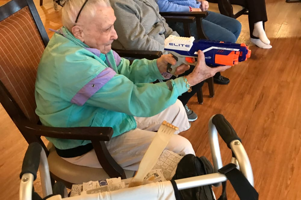 Resident playing with a Nerf gun at Edencrest at Riverwoods in Des Moines, Iowa