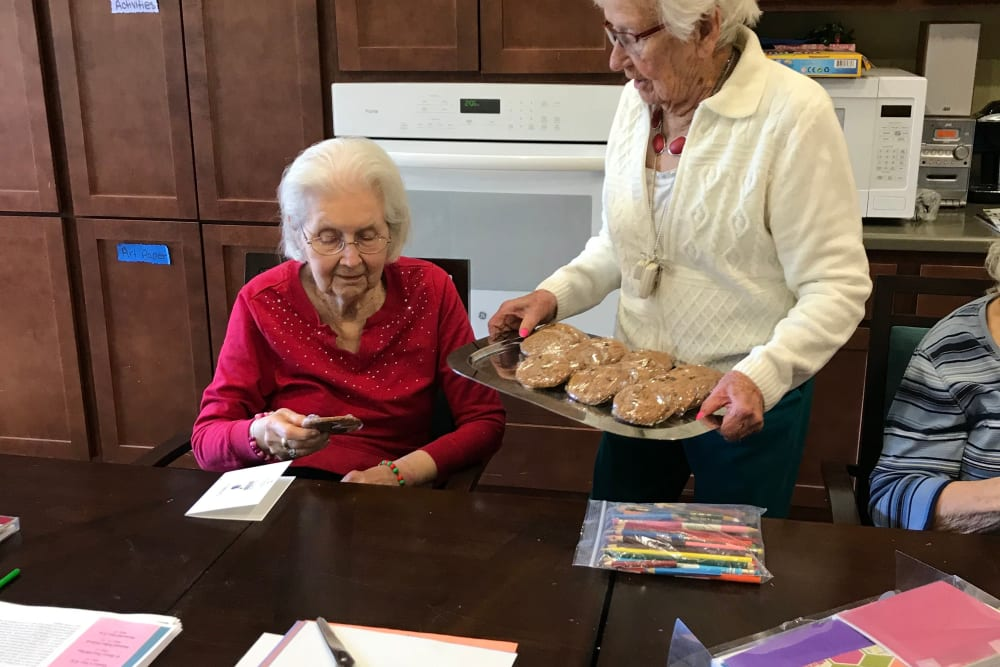 Resident sharing baking goods at Edencrest at Riverwoods in Des Moines, Iowa