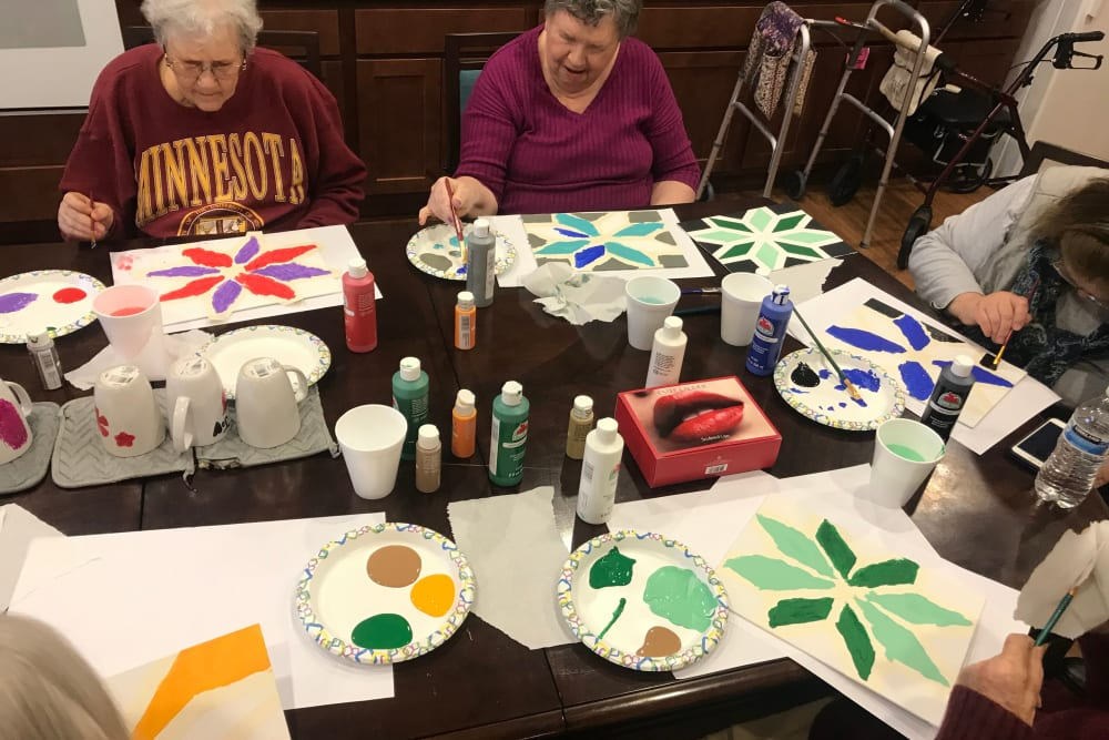 Resident taking an art class at Edencrest at Riverwoods in Des Moines, Iowa