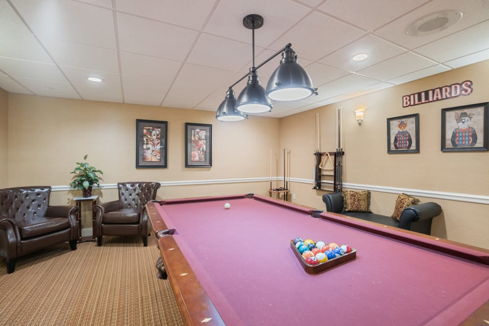 Activity room with a billiards table and other games at The Hearth at Franklin in Franklin, Tennessee