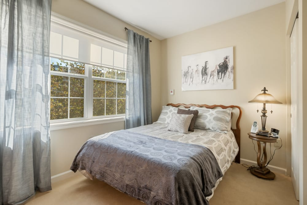 Bedroom with a large bed next to a big window at The Hearth at Franklin in Franklin, Tennessee