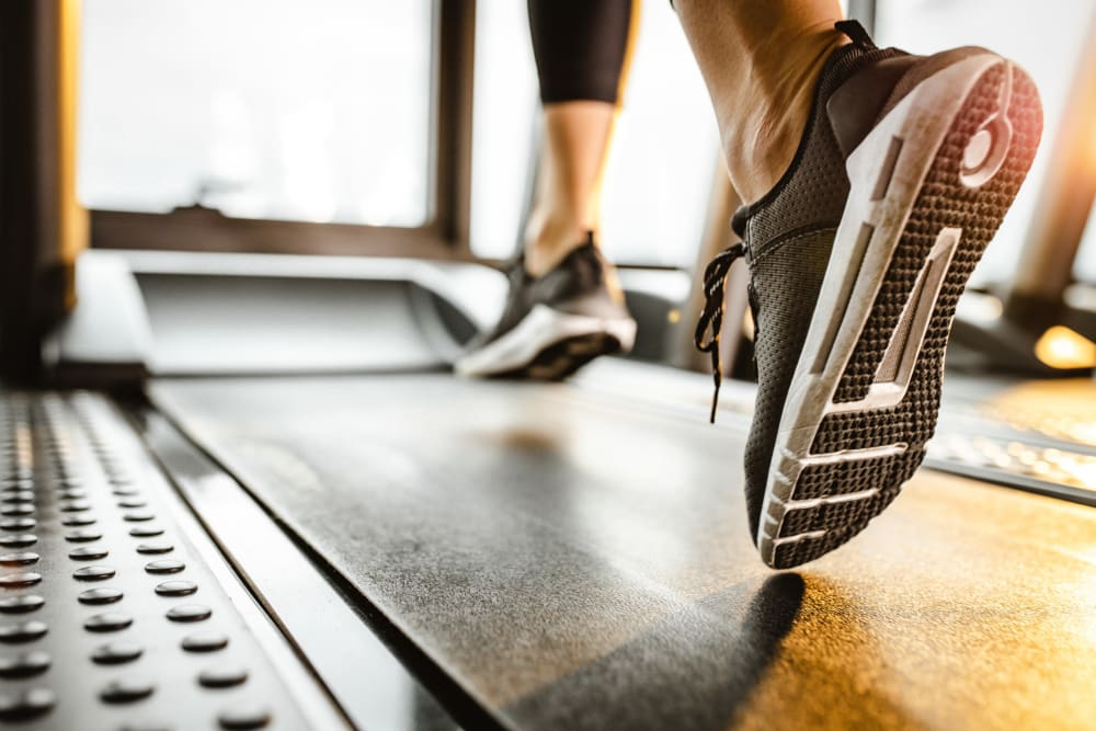 Woman running on treadmill at City View Apartments in Nashville, Tennessee