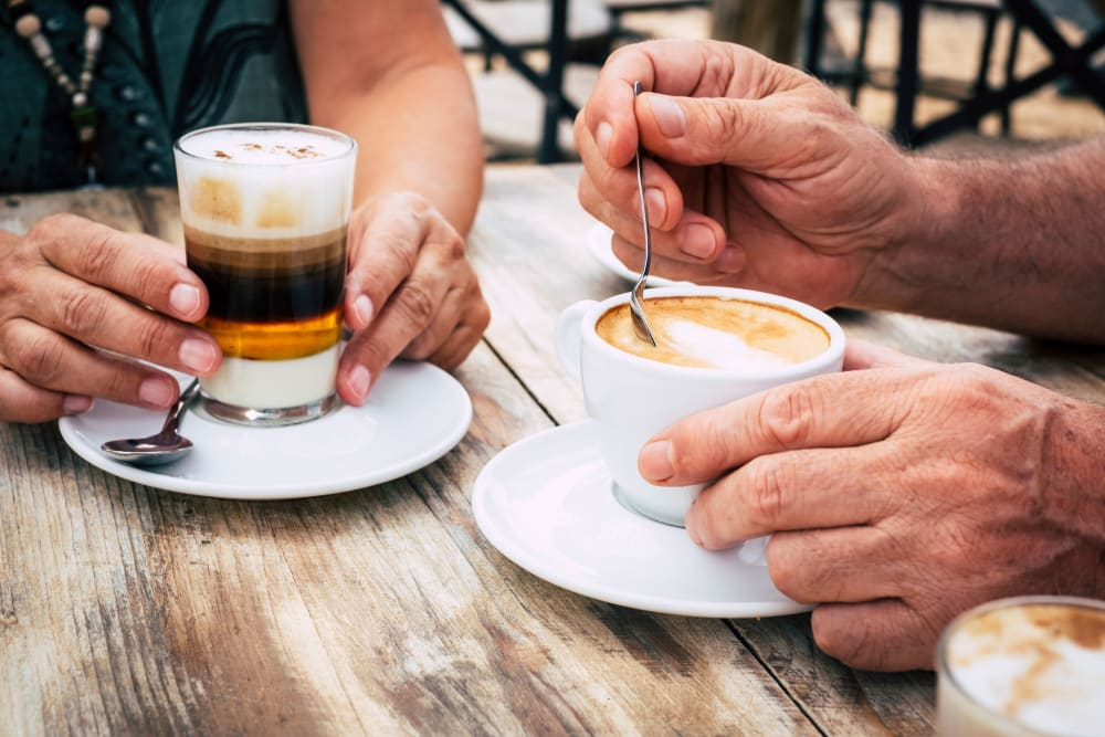 Seniors enjoying coffee at The Meridian at Brandon in Tampa, Florida