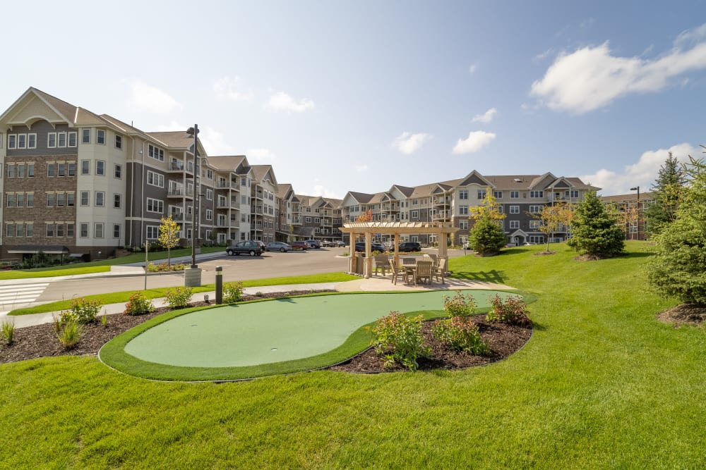 Putting green and pergola at Applewood Pointe Maple Grove at Arbor Lakes in Maple Grove, Minnesota.