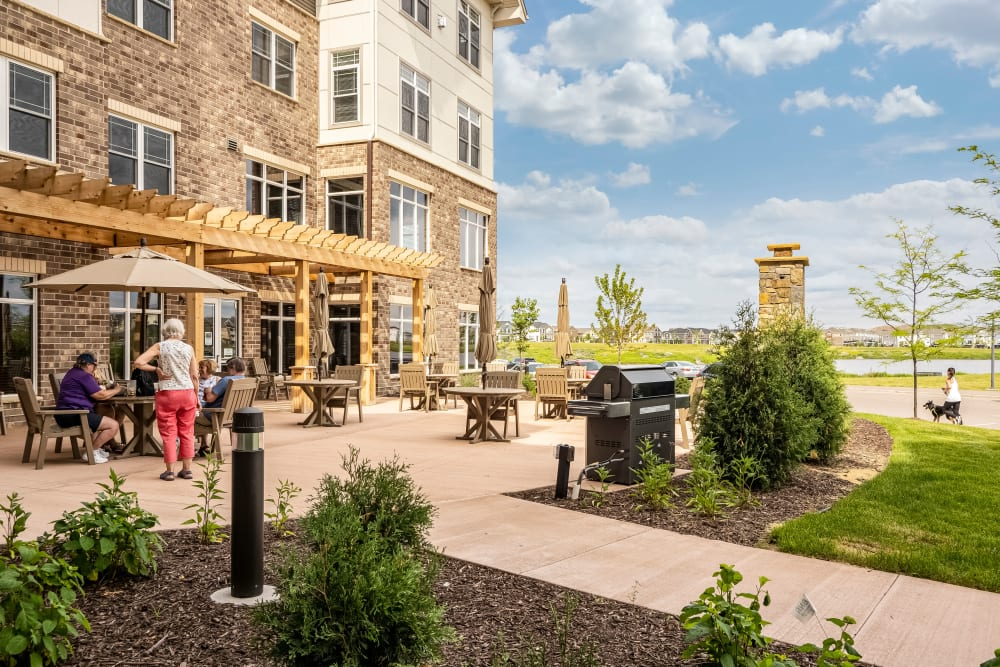 Outdoor patio with grill at Applewood Pointe Maple Grove at Arbor Lakes in Maple Grove, Minnesota
