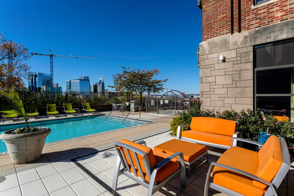 Beautiful poolside seating at City View Apartments in Nashville, Tennessee