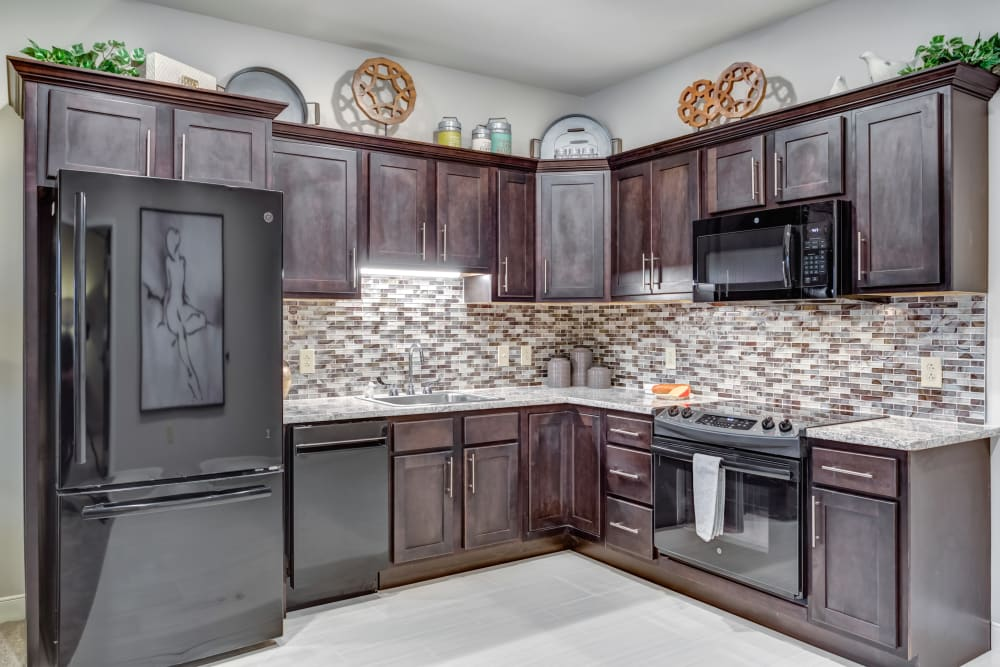 An apartment kitchen with upgraded appliances at Norwich Springs Health Campus in Hilliard, Ohio