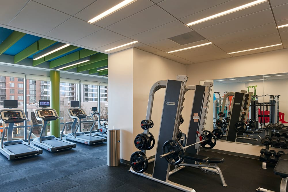 A fitness center with treadmills and weight stations at Solaire 8250 Georgia in Silver Spring, Maryland
