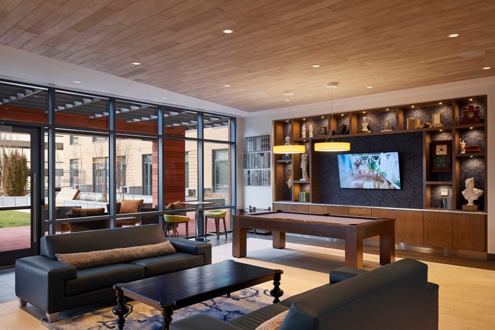 Modern clubhouse lounge with a flat-screen TV at Solaire 8250 Georgia in Silver Spring, Maryland