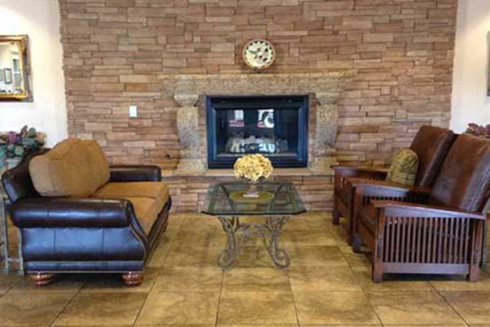 Community living space with fireplace at Pennington Gardens in Chandler, Arizona
