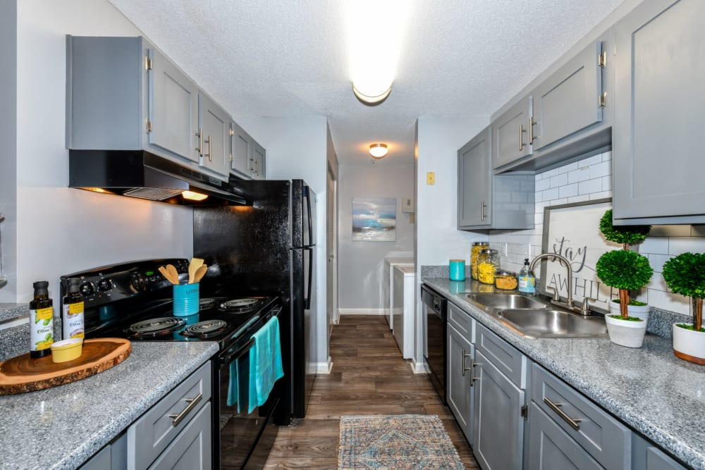 Fully equipped kitchen at 900 Dwell in Stockbridge, Georgia