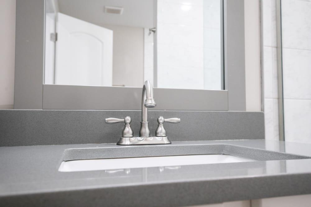 Sink with granite counters at The BelAire Apartment Homes in Marietta, Georgia