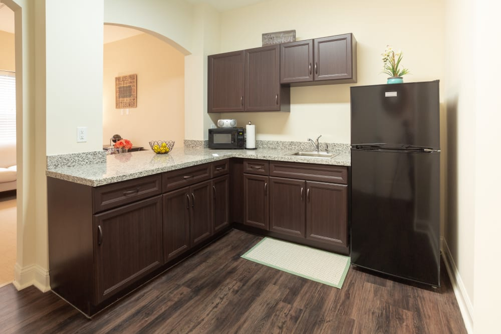 An apartment kitchen at Harmony at West Shore in Mechanicsburg, Pennsylvania