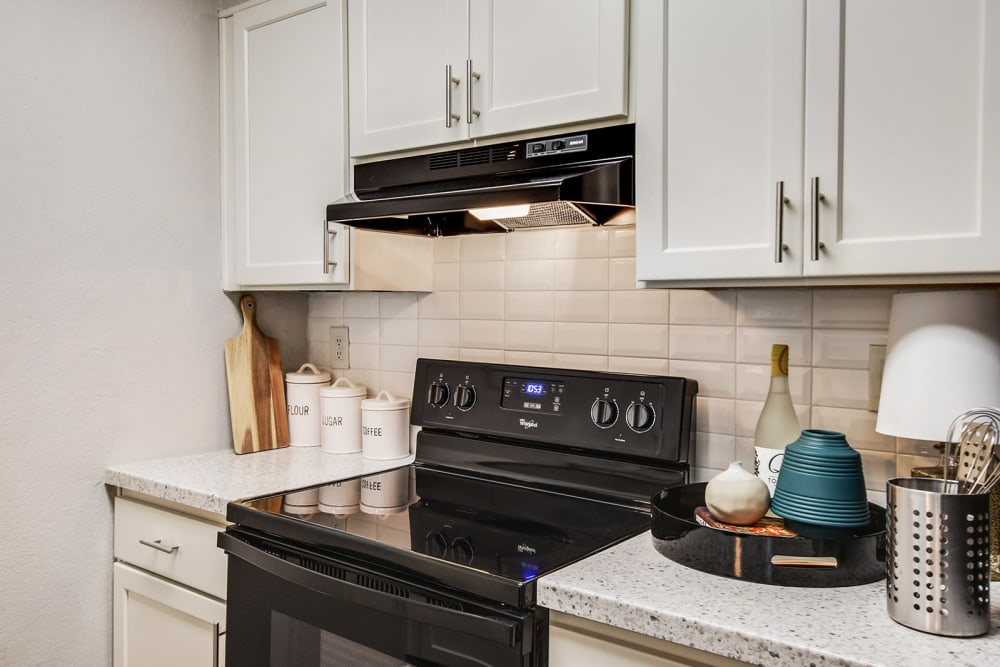 Kitchen with black appliances at The Alcove in Smyrna, Georgia