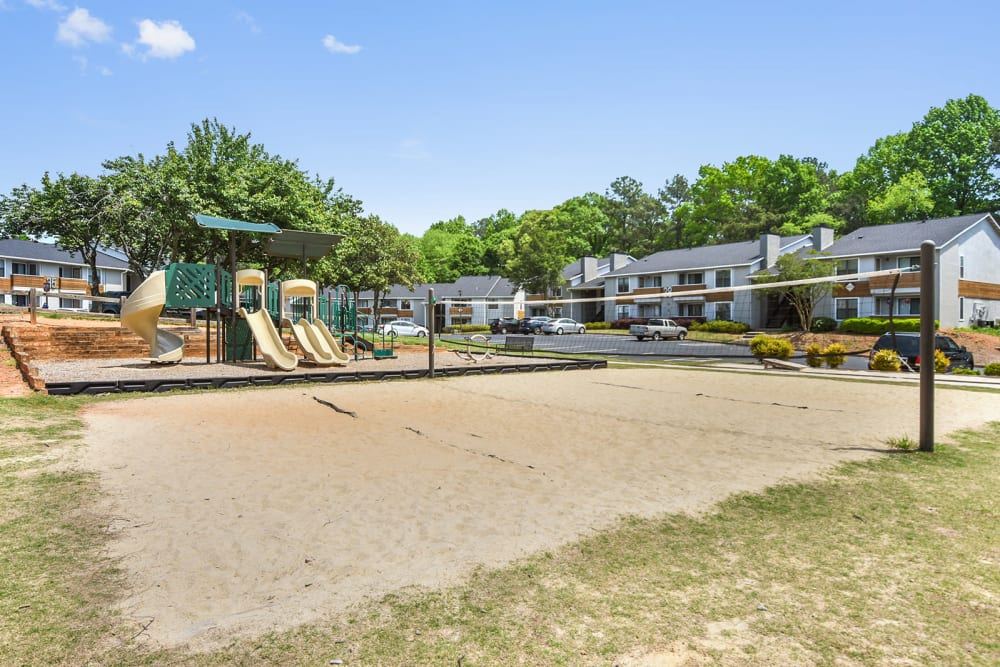 Outdoor volleyball court and playground at The Alcove in Smyrna, Georgia
