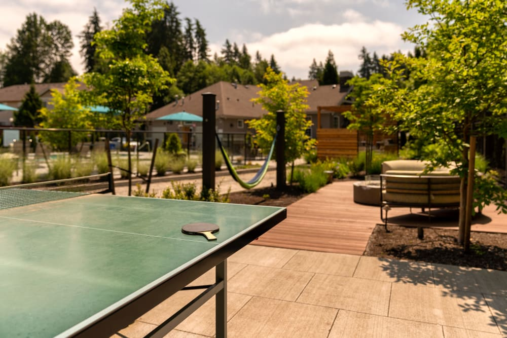 Outdoor activity area with ping pong at Brookside Village in Auburn, Washington