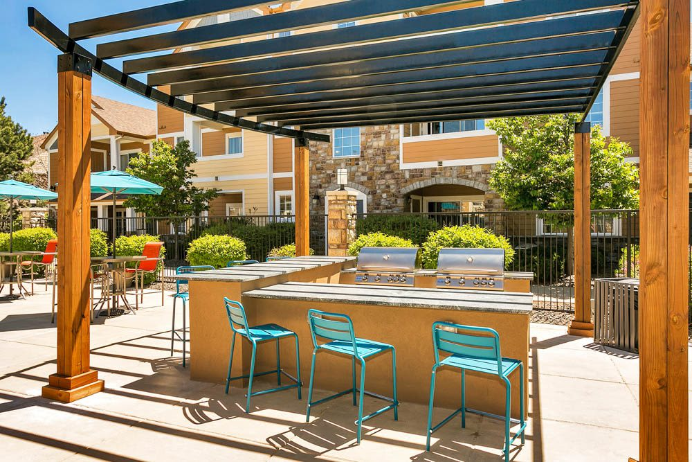 A grilling area by the pool at Crestone Apartments in Aurora, Colorado