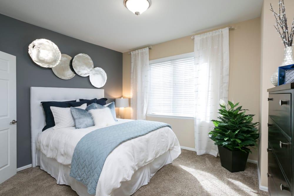 A bright bedroom at Crestone Apartments in Aurora, Colorado