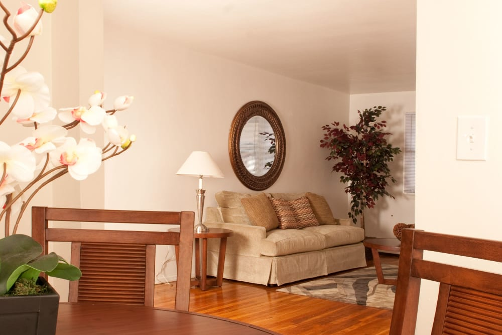 Dining table and sofa in model apartment home of Rosehill Gardens in Elizabeth, New Jersey
