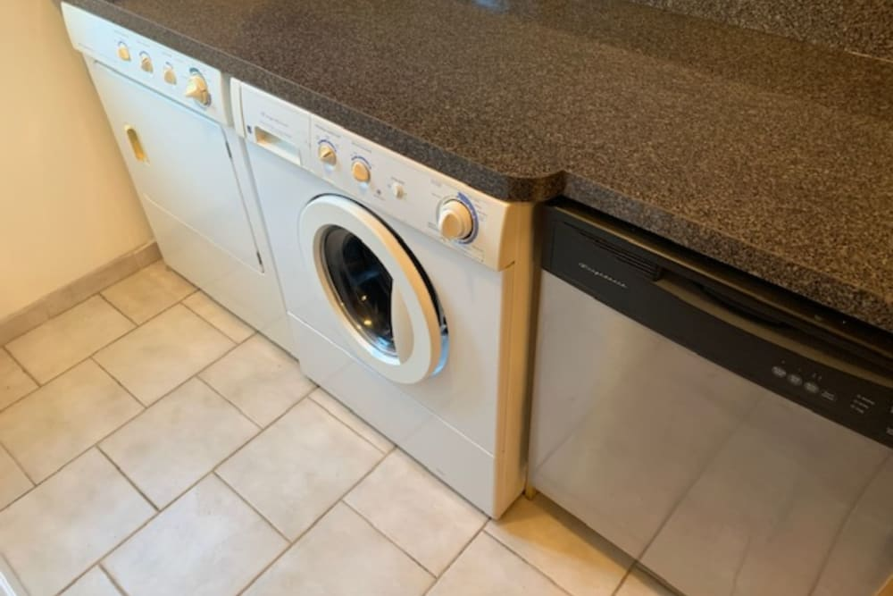 Washer and dryer in model apartment home at Rutgers Court Apartments in Belleville, New Jersey