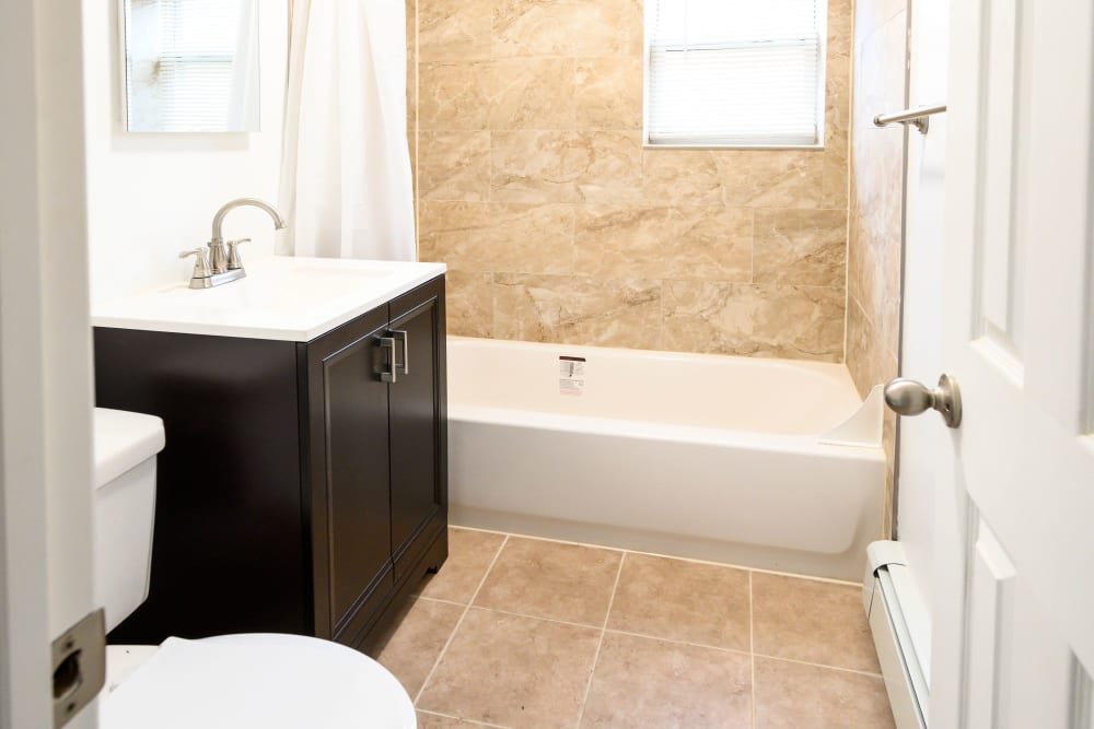 Shower and sink in bathroom at State Gardens in Hackensack, New Jersey
