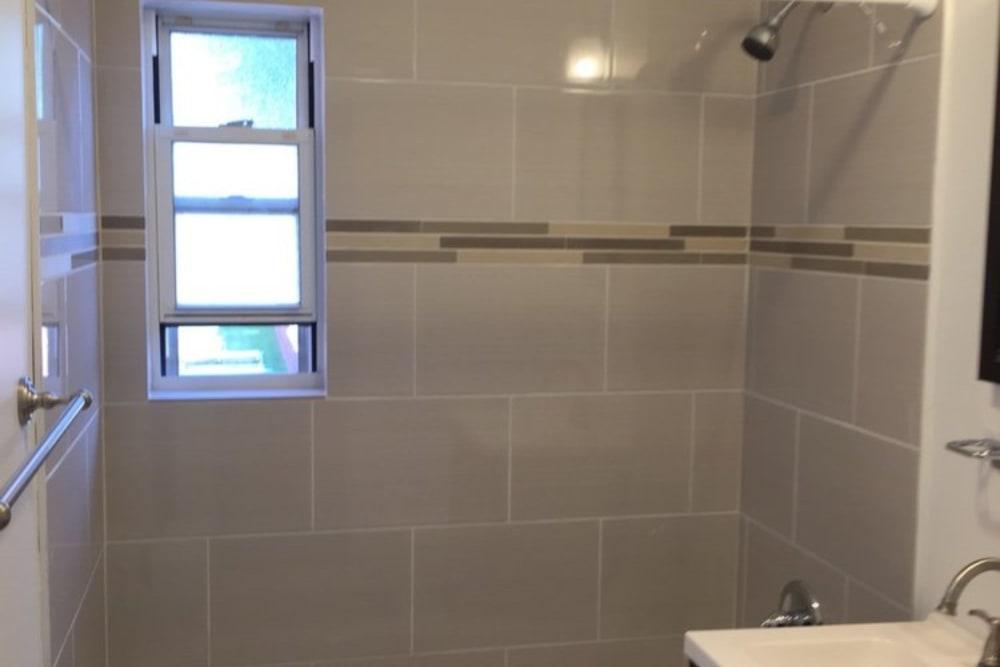 Shower with window in bathroom of Suburban Terrace in Hackensack, New Jersey