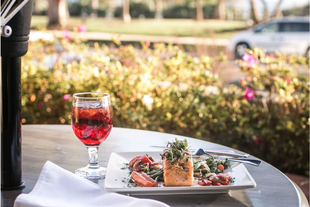 Dinner dish of Salmon and drink at the Meridian at Ocean Villa