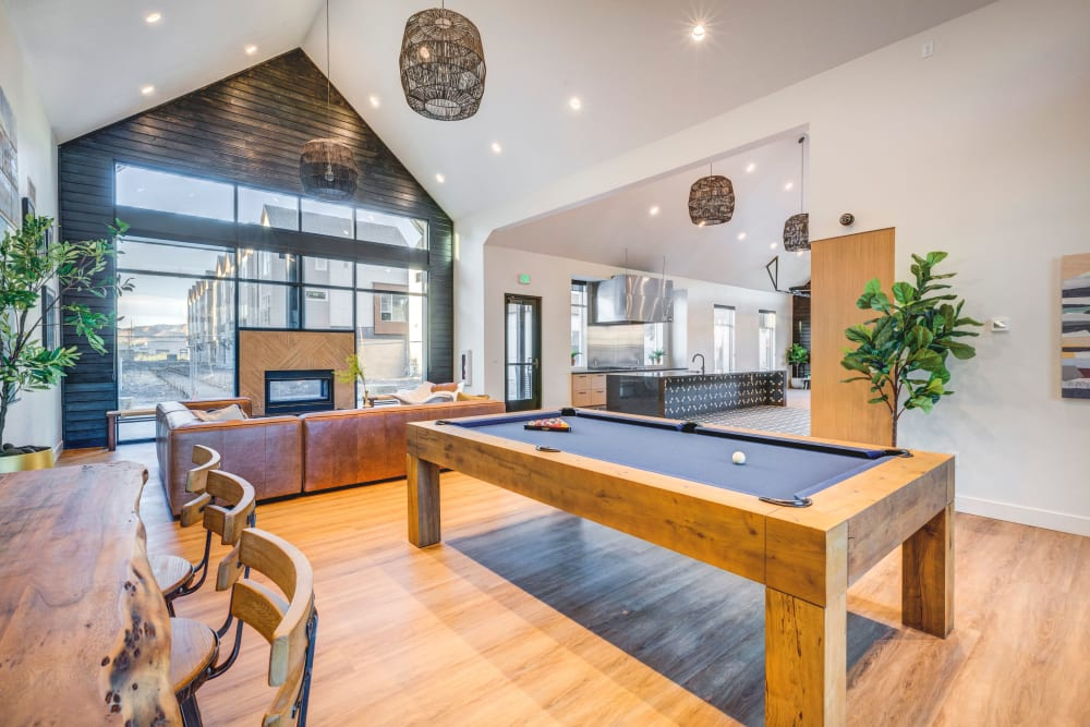 Clubhouse with a billiards table at Hawthorne Townhomes in South Salt Lake, Utah