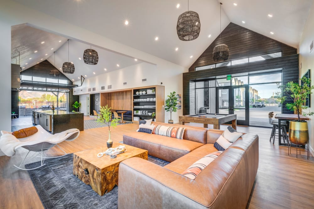 Clubhouse with plenty of seating for entertaining guests at Hawthorne Townhomes in South Salt Lake, Utah