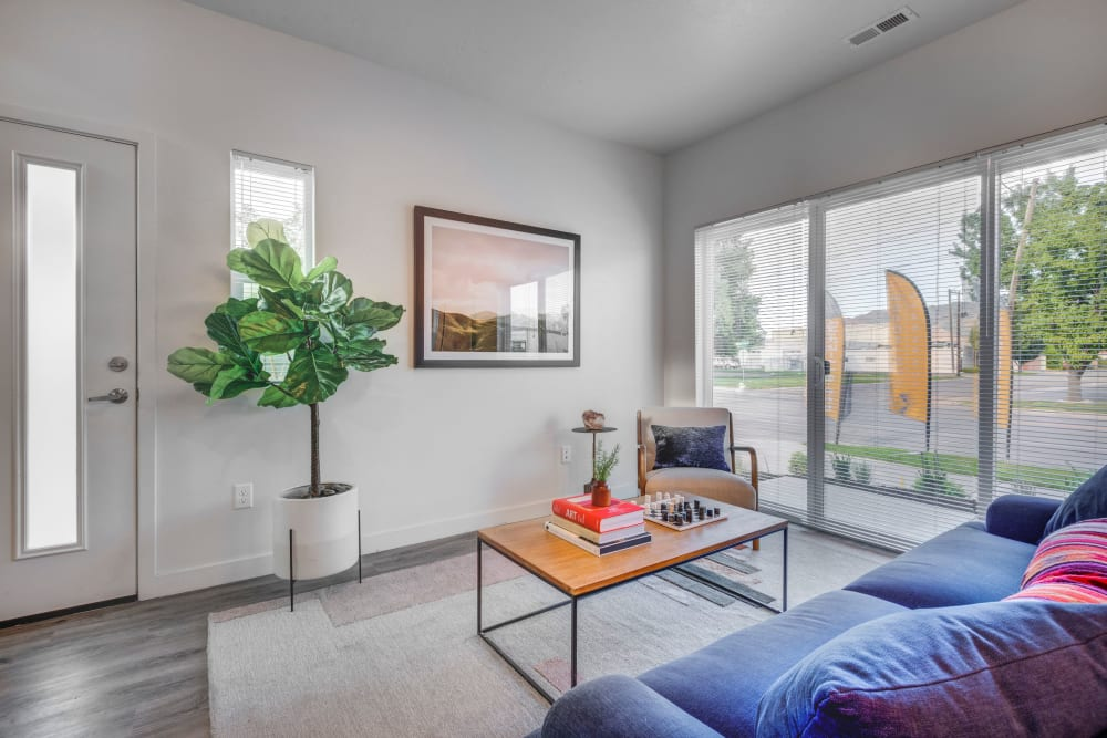 Living room with large windows for natural lighting at Hawthorne Townhomes in South Salt Lake, Utah