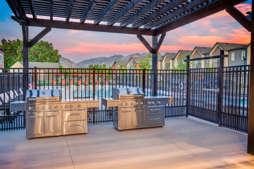 A poolside barbeque area at Hawthorne Townhomes in South Salt Lake, Utah