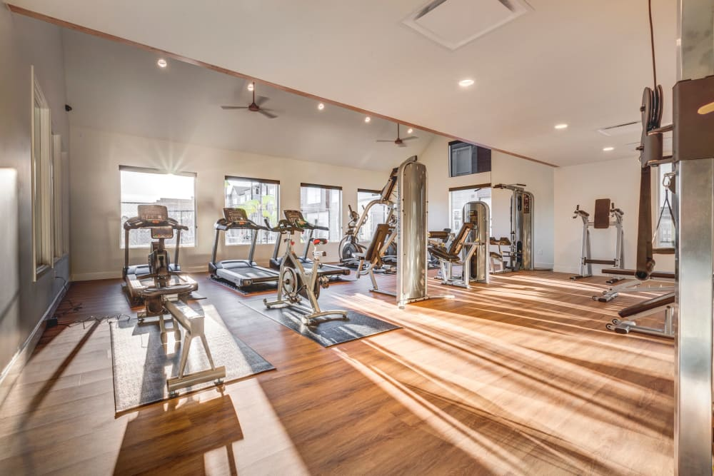 Fitness center with individual workout stations at Hawthorne Townhomes in South Salt Lake, Utah