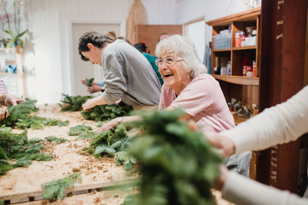 Residents make holiday decorations at Landings of Blaine in Blaine, Minnesota