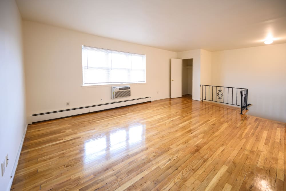 Large living room with hardwood flooring at 84-90 Essex Street in Hackensack, New Jersey