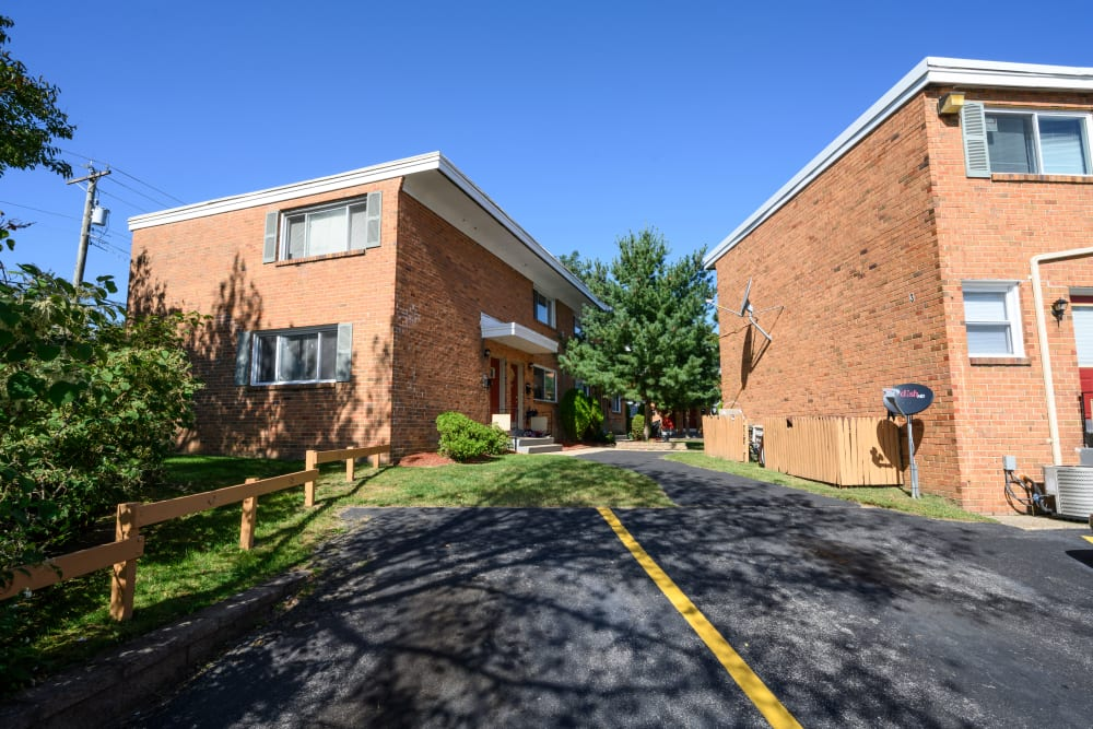 Exterior of buildings on a sunny day at Alpine Court Apartments in Stratford, New Jersey