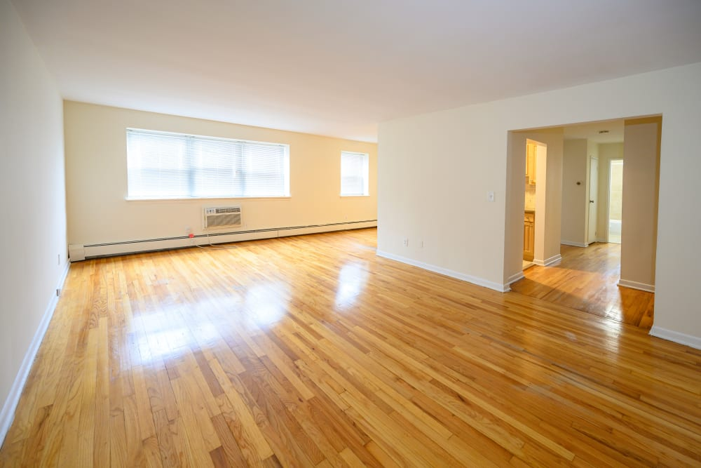 Living room with hardwood flooring at Kennedy Apartments in Hackensack, New Jersey