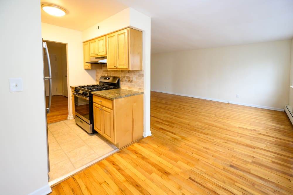 Dining and kitchen layout at Kennedy Apartments in Hackensack, New Jersey