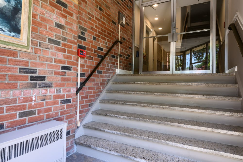 Staircase to foyer at Kennedy Apartments in Hackensack, New Jersey