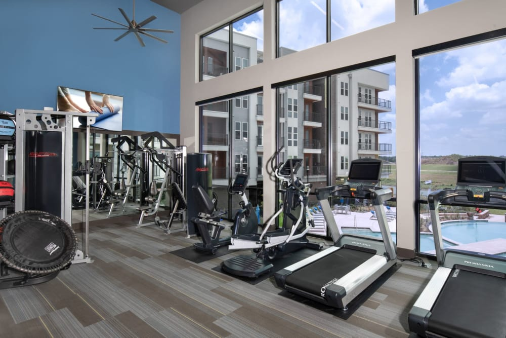 Fully equipped fitness center at Shelby at Northside in Fort Worth, Texas