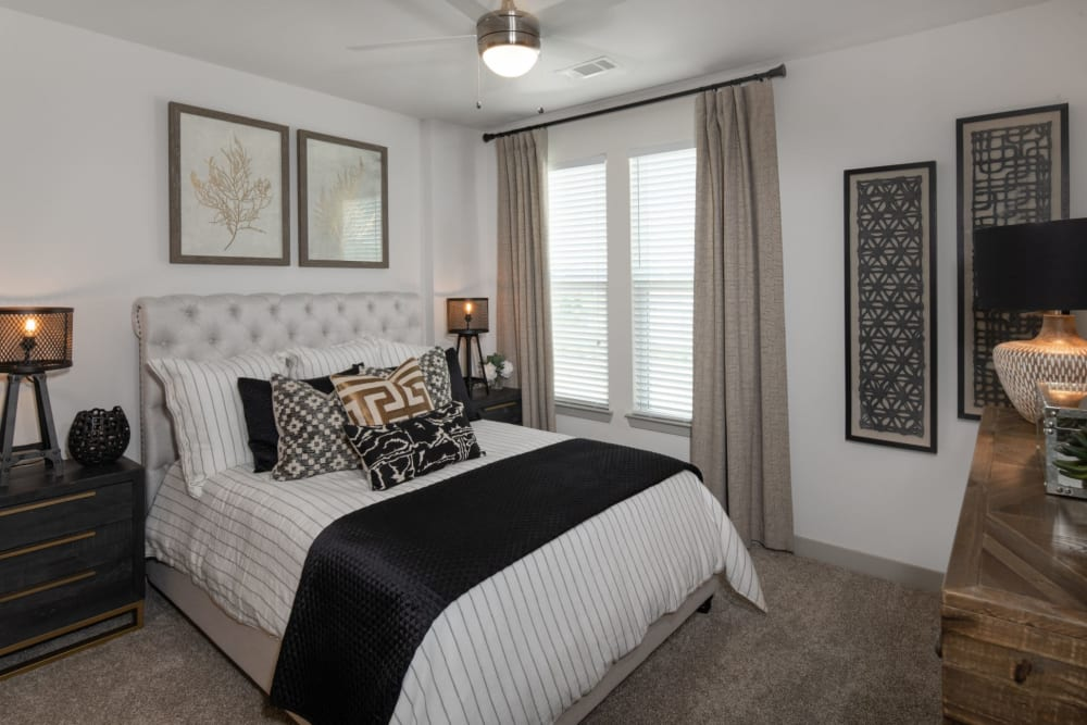 Cozy bedroom with a large window at Shelby at Northside in Fort Worth, Texas