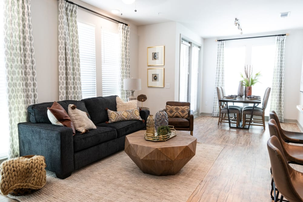 Living room with patio access at Shelby at Northside in Fort Worth, Texas