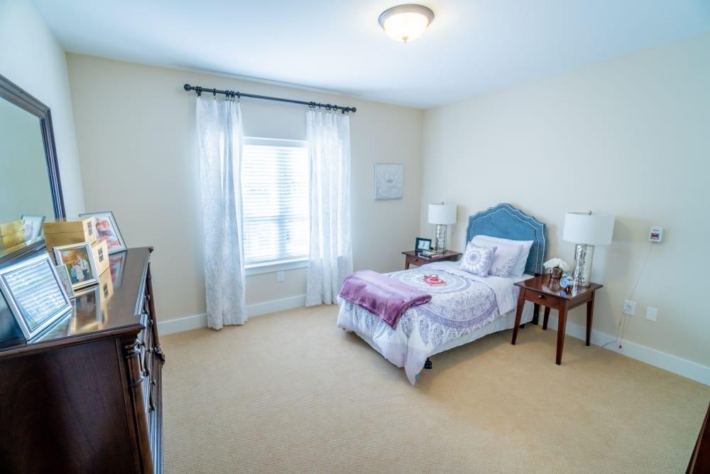 A spacious bedroom at Harmony at Harts Run in Glenshaw, Pennsylvania