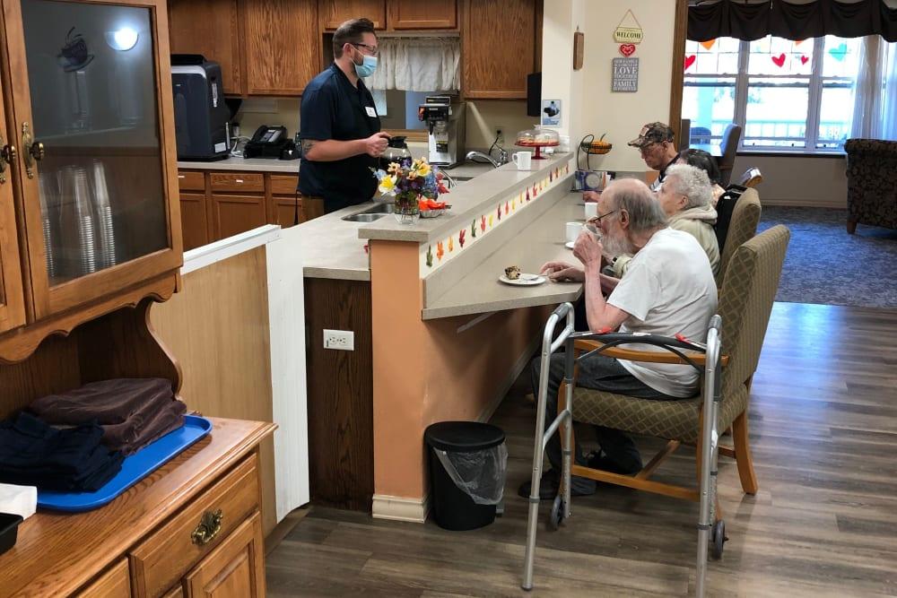 Residents enjoy coffee service at Landings of Sauk Rapids in Sauk Rapids, Minnesota